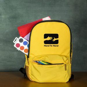 hands 2 hand back school supplies merch nonprofit fundraiser philadelphia back pack school bag yellow