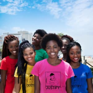 Group of six beautiful african american woman in colorful shirts
