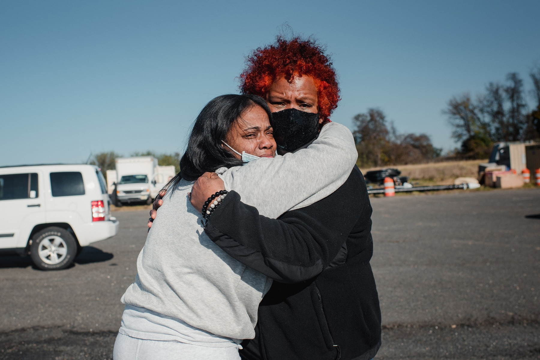 Hannah Yoon professional photographer photography social justice african american women embracing hugging crying sad upset new jersey inmate release red hair masks covid