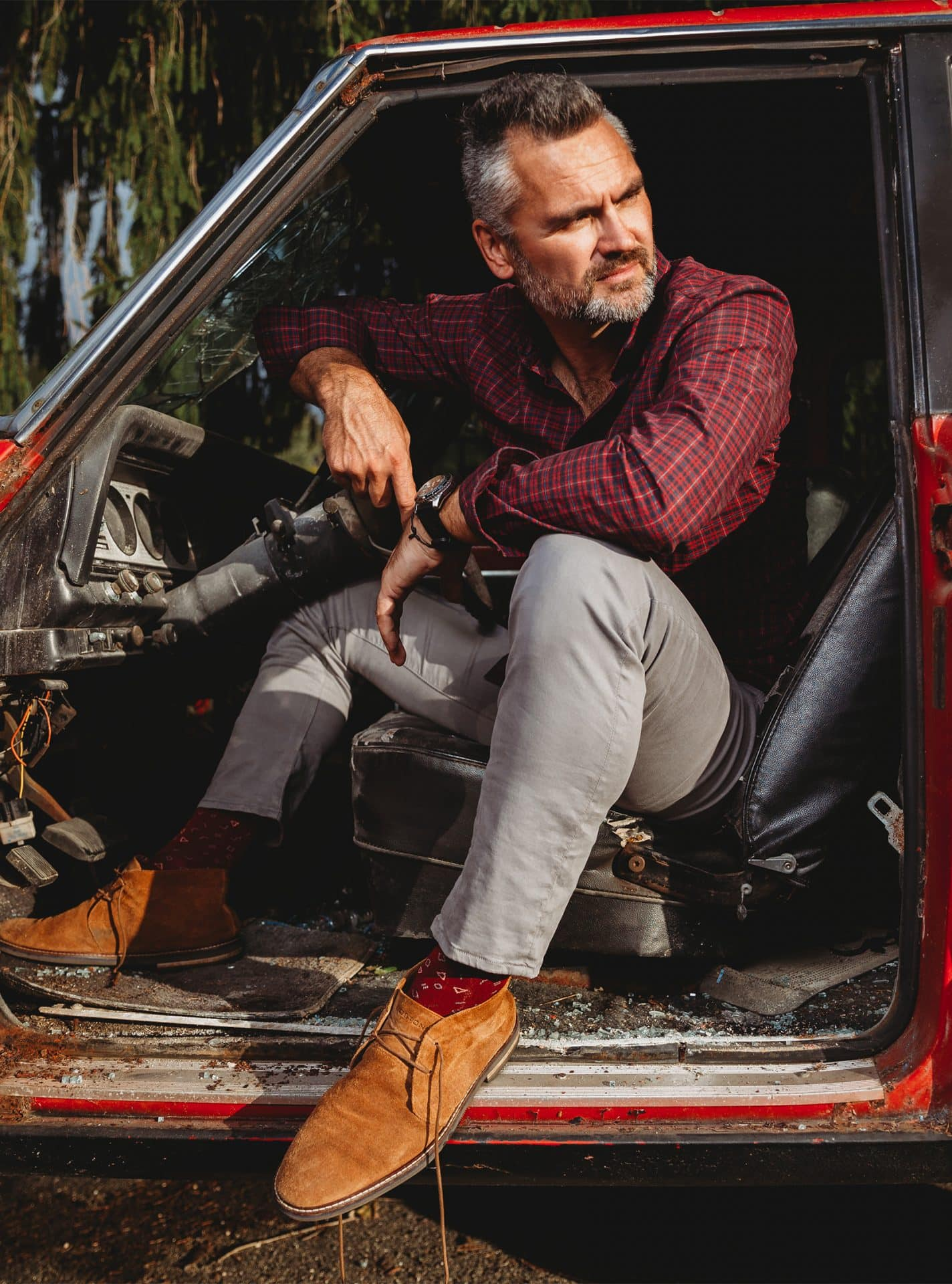 Mike Mielcarz professional photographer gray hair beard man red flannel truck open door brown shoes watch creative repute