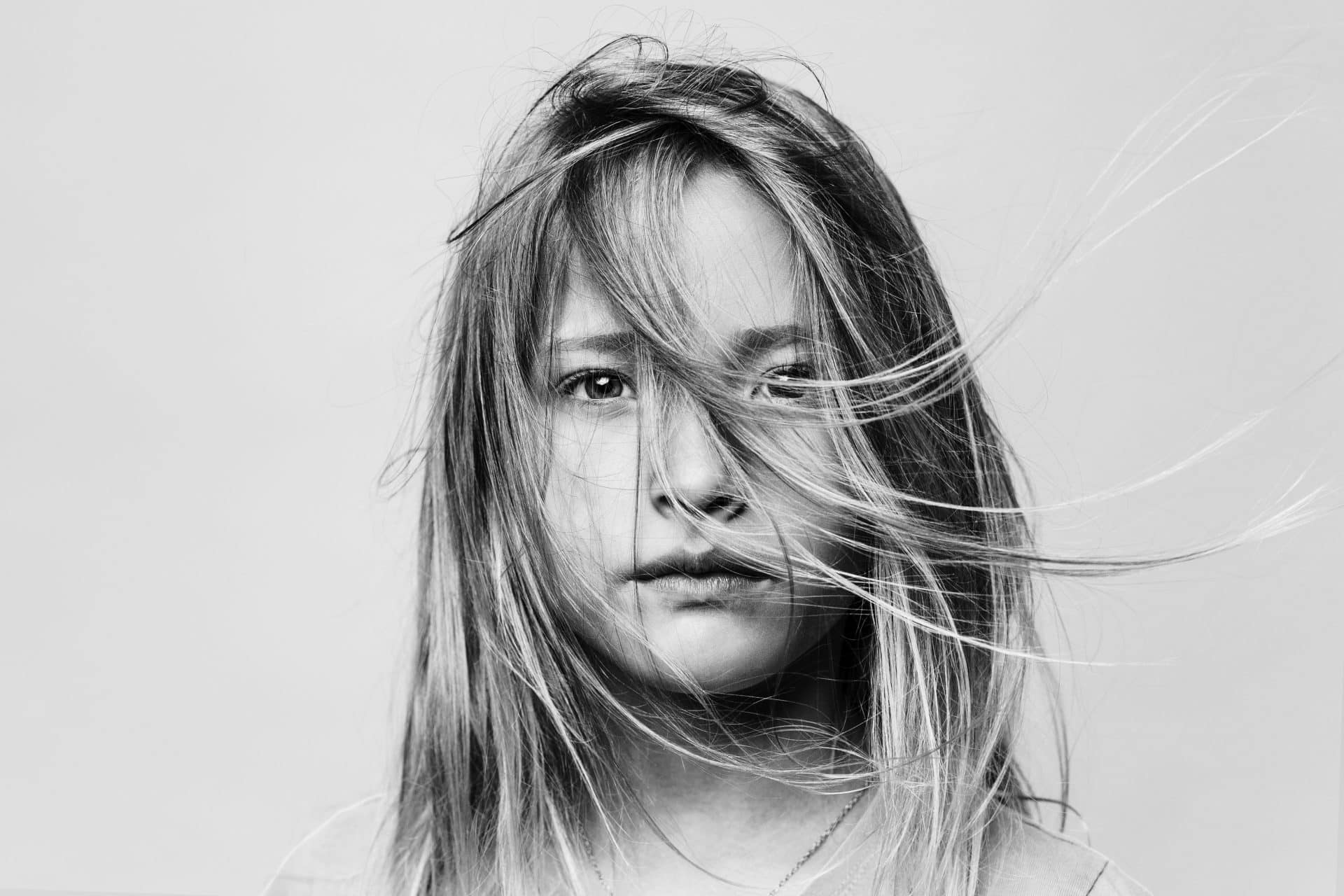 Mike Mielcarz professional photographer little girl stoic gray portrait messy hair child creative repute