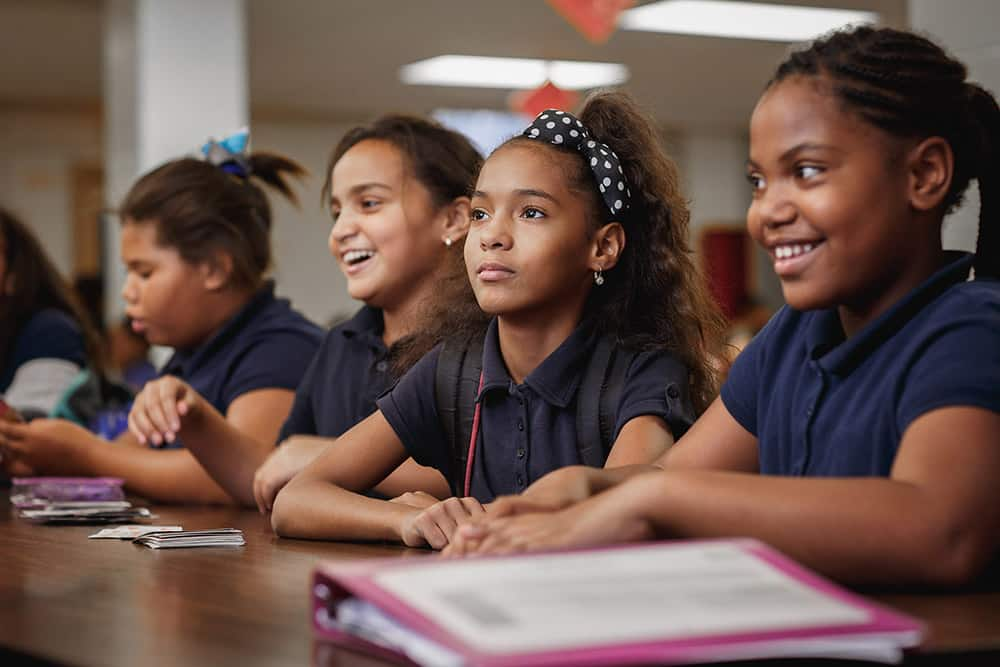 matthew stanley professional lifestyle photographer african american poc students girls classroom elementary middle school serious listening lecture laughing smiling learning creative repute education nonprofit